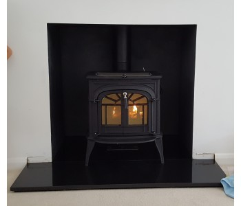 Vermont Intrepid 2 Catalytic Wood Stove - in classic black with a black polished granite hearth. Installed in Guildford, Surrey