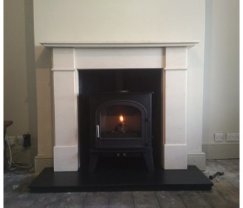Cleanburn Skagen 5 Multifuel stove - installed with Flat Front Victorian limestone fire surround and riven slate hearths installed by our HETAS engineers in a traditional Victorian town house near Esher, Surrey.