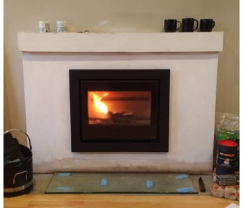 Pevex Serenity 45 inset multifuel stove - with four sided frame installed with glass hearth in Guildford, Surrey.