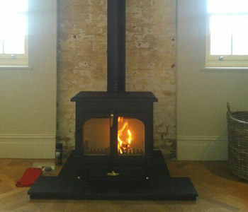 Clearview Vision 500 multi fuel stove  - installed with thermally insulated twin wall chimney system in Surrey Hills.
