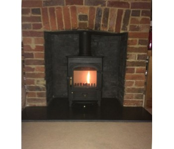 Clearview Pioneer 400 multifuel stove - with flat top in matt black with a Black Slate hearth in Godalming, Surrey.