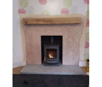 Charnwood C4 Woodburner in Gun Metal - with limestone hearth and oak beam near Caterham, Surrey.