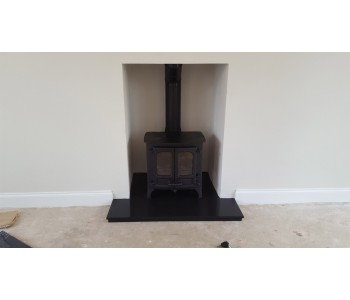 Charnwood Island 1 Stove -  with low legs in black with black slate hearths installed in Ripley, near Woking, Surrey.