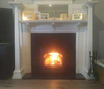 Hunter Stoves Group Telford Inset 5 multifuel stove - with slate hearth, slips and header into existing wooden mantle piece in a beautifully refurbished home in Godalming, Surrey.