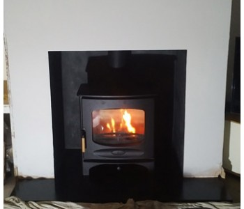 Charnwood C7 woodburner - installed on black slate hearth in Guildford, Surrey.