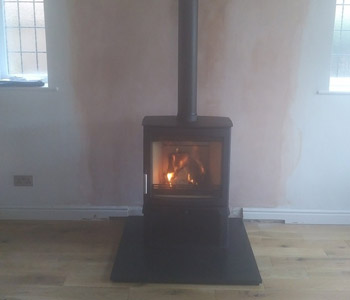 Parkray Aspect 8 Slimline woodburner - with Store Stand and Poujoulat UK ltd External Chimney System with Slate hearth between Reigate and Dorking, Surrey. Another satisfied customer...