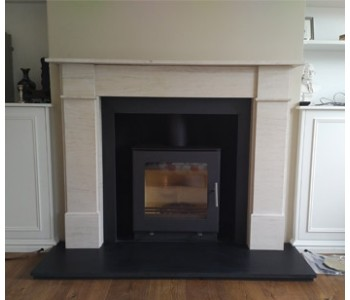Westfire Uniq 23 Woodburner -  with flat door and block base installed with honed black granite hearths and the Flat Front Victorian limestone surround