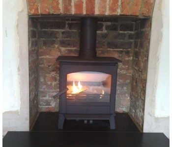 ACR Earlswood Multfuel Stove fitted by our HETAS installers - with black slate hearth in Godalming, near Guildford, Surrey.