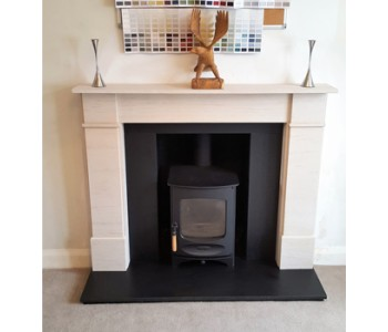 Charnwood C4 Woodburner in black with - Flat Front Victorian and Honed Black Granite hearths, slips and header fitted by our installers in Shalford near Guildford, Surrey.