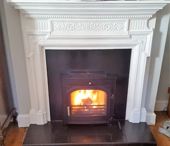 Hunter Telford Inset 8 Multi-fuel Stove - installed with slate slips and header into period fireplace in Walton-on-Thames, Surrey.