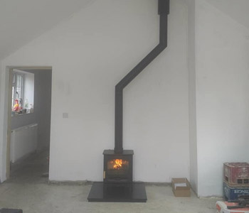 Charnwood Stoves C5 woodburner - on a slate hearth with thermally insulated, twin wall chimney system