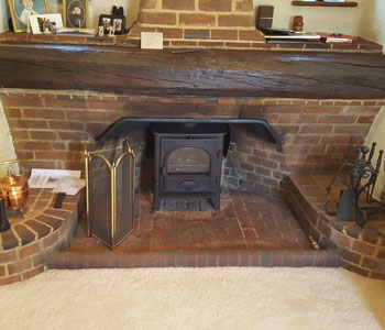 Stovax Stockton 5 Wood Burning Stove - with flat top installed in beautiful Arts and Crafts original fireplace in the Surrey Hills between Guildford and Dorking