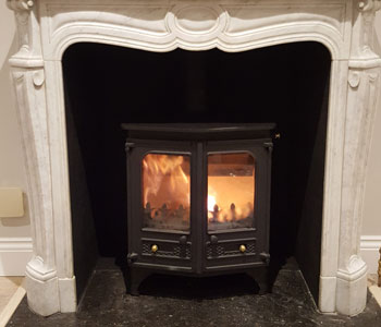 Charnwood Country 6 Wood Burner - installation into Louis IX marble fireplace with polished granite hearths in Claygate, near Esher, Surrey.