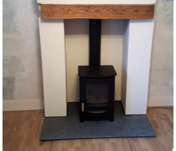 Charnwood C6 Log Burner - fitted by our installers with a Green Slate hearth in Bramley near Guildford, Surrey.