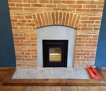Di Luso R4 Inset Wood Burning Stove - with 3 sided frame in black with bespoke Vlaze fire surround in Basalt fitted by our installers in East Horsley between Guildford and Leatherhead, Surrey.