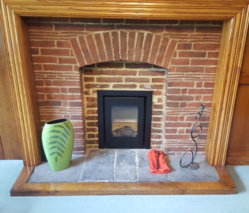 Di Luso R4 Inset Wood Burner - with 3 sided frame in black installed in wonderful, original Arts & Crafts property between Guildford and Leatherhead, Surrey.