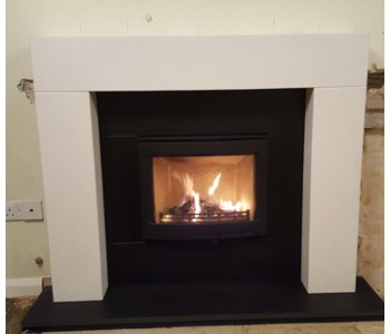 Contura i5 Inset Woodburning Stove - fitted with Stonehenge limestone mantel piece and honed black granite hearth, slips, footer and header in Farnham, Surrey.