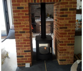 Mendip Churchill 8 Double Sided Multi-fuel stove - completed with bricks slips by our installers in Woking, Surrey.