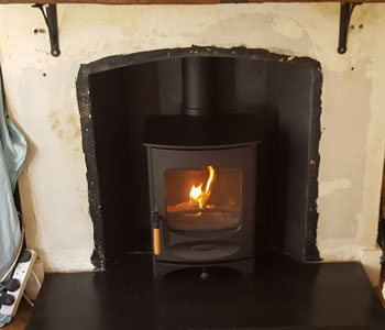 Charnwood C4 Wood Burning Stove - fitted by our installers in Peaslake in the heart of the Surrey Hills near Guildford.