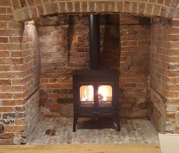 Charnwood Island 2 Cooker Top Stove -  with high legs in black installed by our stove fitters in Sutton, Surrey