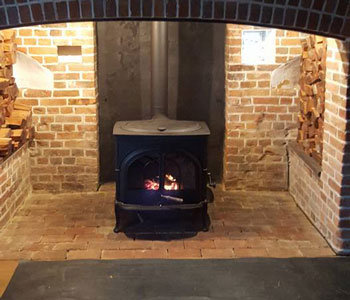 Vermont Intrepid Wood Burner - installation into beautiful period inglenook fireplace in the Surrey Hills, between Guildford and Dorking.