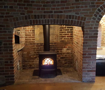 Jotul F3 Traditional Wood Burner - in matt black installed between Cranleigh and Guildford, Surrey.