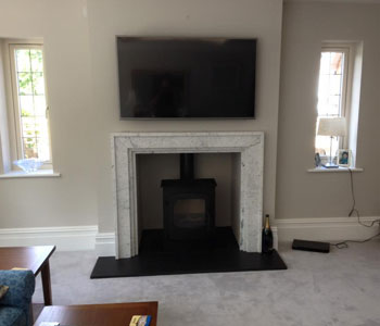 Charnwood Cove 2 Stove - with low stand in black fitted by our installers in Guildford, Surrey.