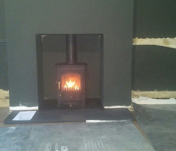 Clearview Stoves Pioneer 400 wood burning stove - was installed with Antique granite hearth in Godalming, Surrey.