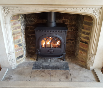 Jotul F3 TD Standard Woodburner - in matt black with short legs. Installed in Effingham, Surrey