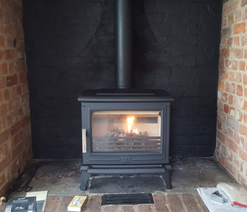 ACR Rowandale Multifuel Stove - in matt black. Installed in Shere near Guildford, Surrey