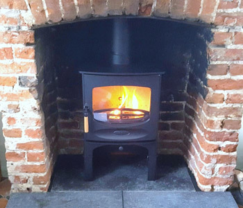 Charnwood C5 Woodburner - with store stand in black. Installed near East Horsley near Leatherhead, Surrey