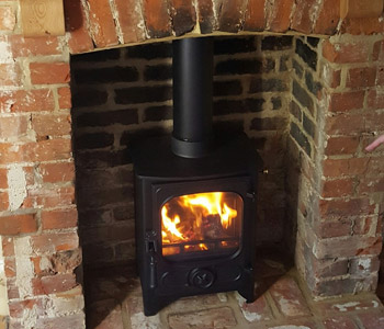 Charnwood Country 4 Woodburner - in matt black. Installed near West Clandon near Guildford, Surrey