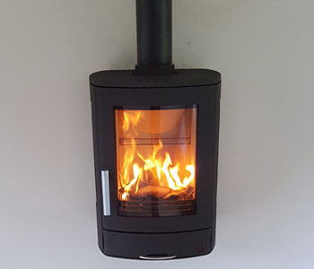 ACR Neo 3W Multifuel Stove - in black with a honed granite hearth. Installed in Guildford, Surrey