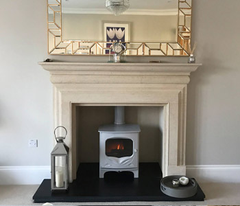 Charnwood Bembridge Woodburner - in French Grey.  Installed near Cobham, Surrey