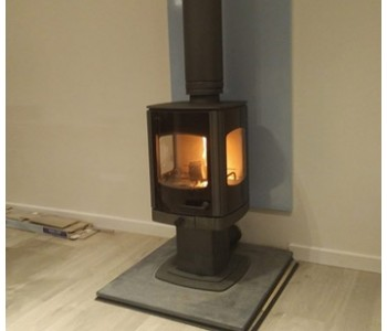 Charnwood Tor Pico Woodburner in Gun Metal - with a thermally insulated twin wall chimney system also in Gun Metal, internally with Riven slate hearth and Vlaze heatshield in Duck Egg