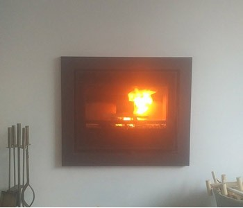Pevex Stove Serenity 45 Inset stove - with four sided frame in Reigate, Surrey. A very clean, modern look!